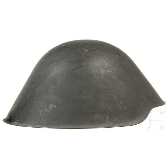 Three GDR steel helmets M 56, 1950s - 1980s