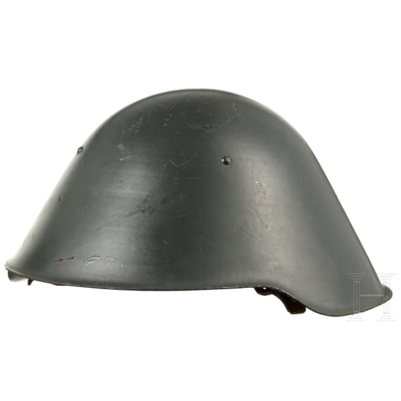 Two steel helmets with helmet covers, 1960s - 1970s