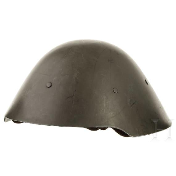 Six M 56 helmets, 1950s - 1980s