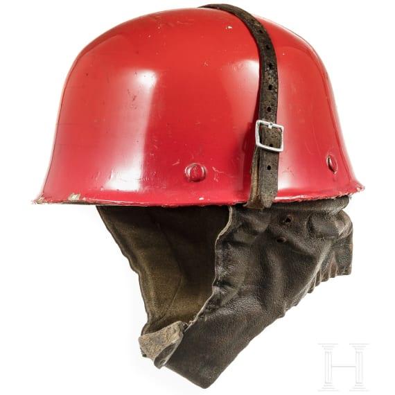 Five helmets for paramedics or firemen, 1950s - 1980s