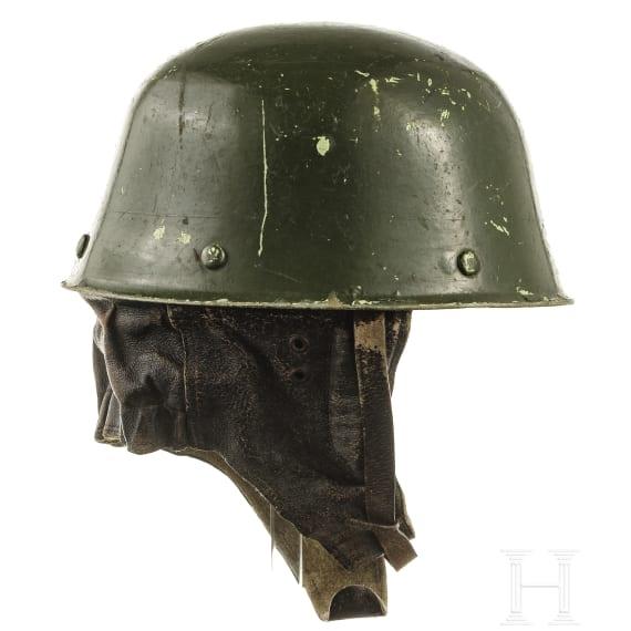 Three helmets with insignia, 1950s - 1970s