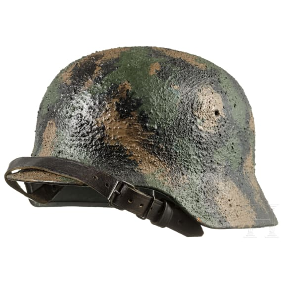 A steel helmet with later camouflage paint, 1970s - 1980s