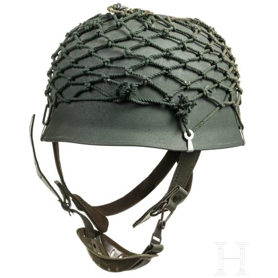 Two steel helmets based on paratrooper models, 1950s - 1970s