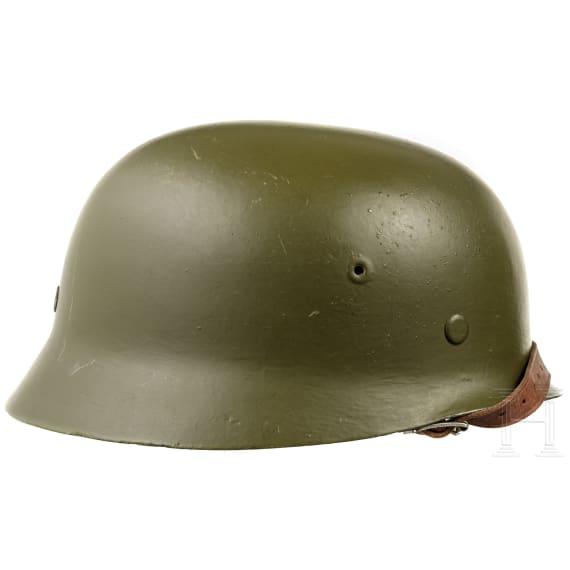 Four helmets after German models, 1950s - 1980s