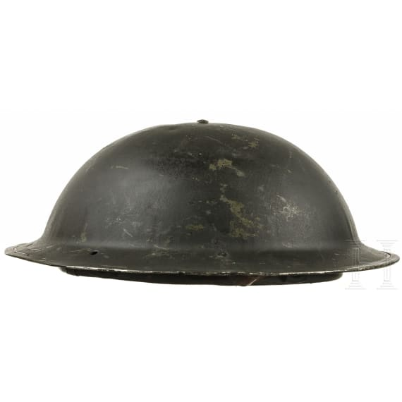Three British steel helmets, 1940s - 1960s