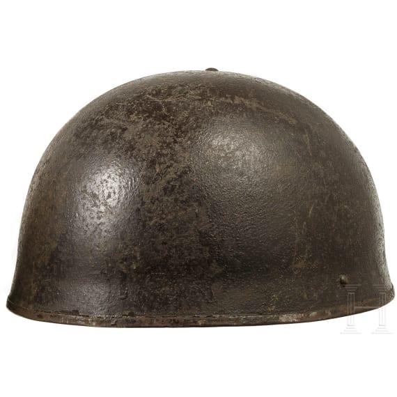 Three British pattern steel helmets, 1940s - 1970s
