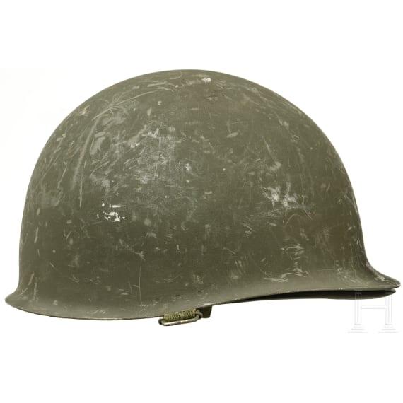 Two Spanish/US-American steel helmets M 1, 1970s - 1980s