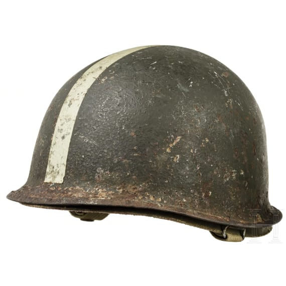 Two M1 style steel helmets, US allies, 1950s - 1980s