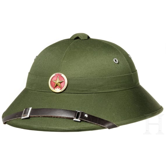 Two Vietnamese pith helmets, 1960s - 1980s