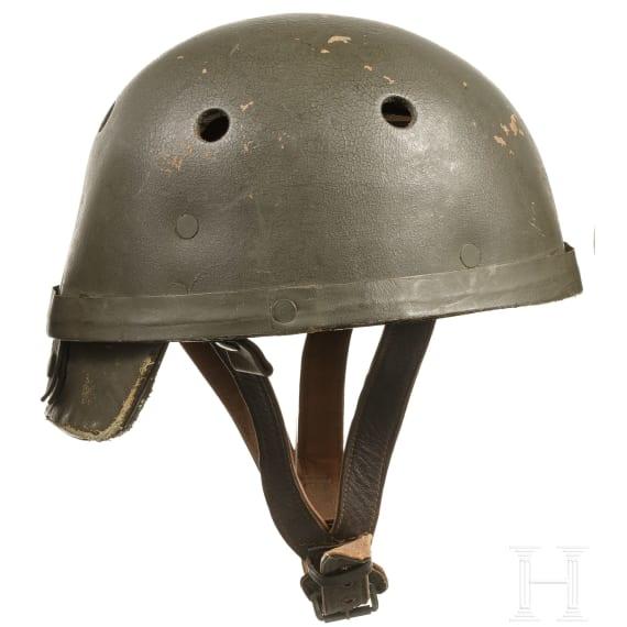 Three Western European tanker helmets, 1940s - 1970s