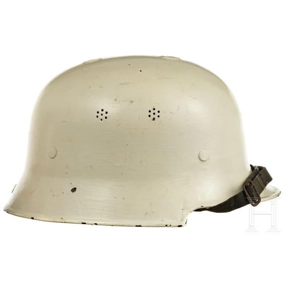 Five international helmets of Fire brigade, Red Cross, Civil Defence, 1950s - 1990s