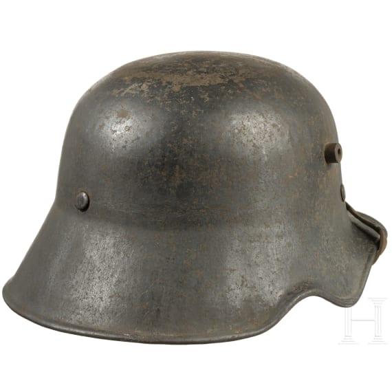 A German steel helmet M 18 with ear cut-out, 1920s