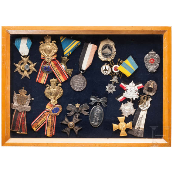 A collection of 16 early badges and awards from veteran associations, Prussia, Lippe and others