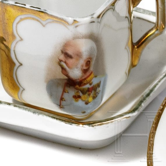 A Russian plate and two cups, circa 1900