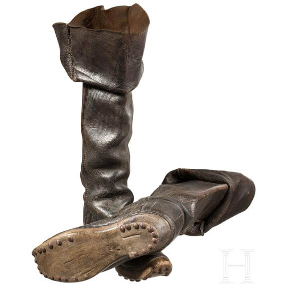 A pair of leather boots with nailed wooden soles, 19th century