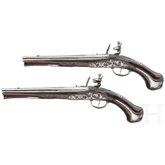 A pair of flintlock cavalry pistols by LeRoy à Paris, circa 1710/20
