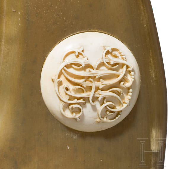 A German ivory-mounted powder flask, circa 1700
