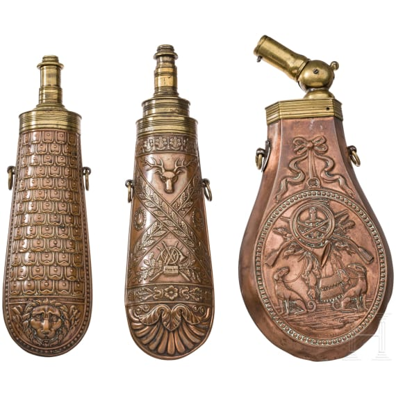 Three copper powder flasks, France, mid 19th century