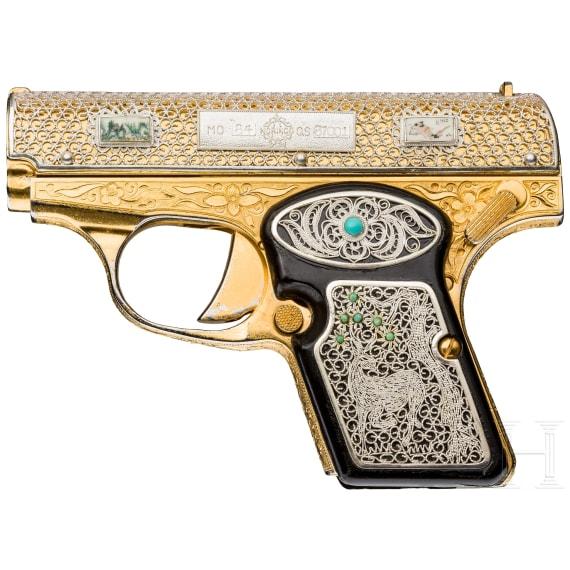 A cased Norinco M 84 in gold finish